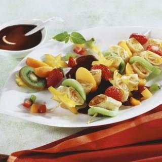Pancake kebabs with fruit and chocolate sauce